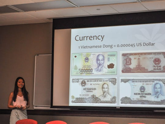Michelle Lu presents Vietnam, teaching the student body about various aspect of Vietnamese life, including currency.