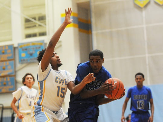 Dover's Stephen Justice is fouled by Cape Henlopen's