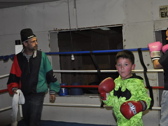 Ramon Guiterrez looks oni as Angelie Garcia spars with coach Andy Gonzales at the Rocks Boxing Club in Ruidoso Downs.