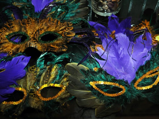 Get into the spirit of Mardi Gras with feathered masks and lots of beads.