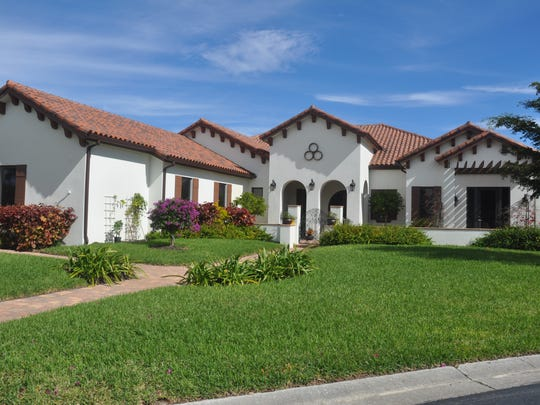 This home by Danata in Wildcat Run has a Mediterranean look on the outside, but a more modern look on the inside.