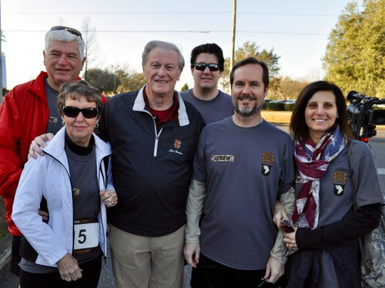 President Thrasher poses with the Sisson family at the race.