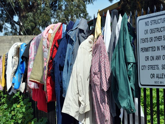 Clothes dry along a fenced-off area in Salinas' Chinatown