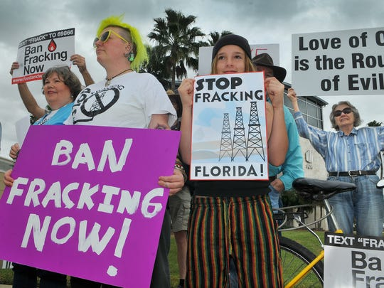 Krystal Osborne of Orlando and Jayda Stratos of Satellite Beach take part in a recent anti-fracking protest in Cape Canaveral.