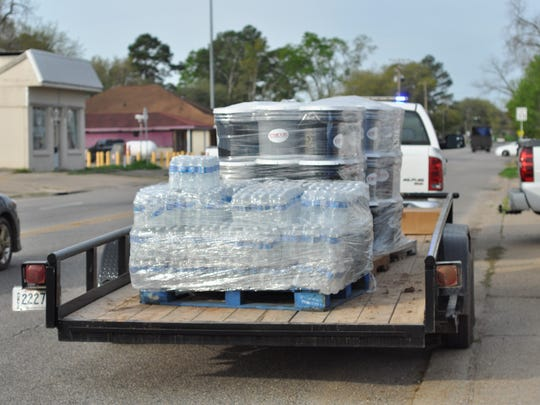 The Grant Parish Sheriff's Office with the help of the Louisiana Army National Guard on Wednesday delivered pallets full of water bottles, buckets of cleaning supplies and towels to flood victims across the parish.