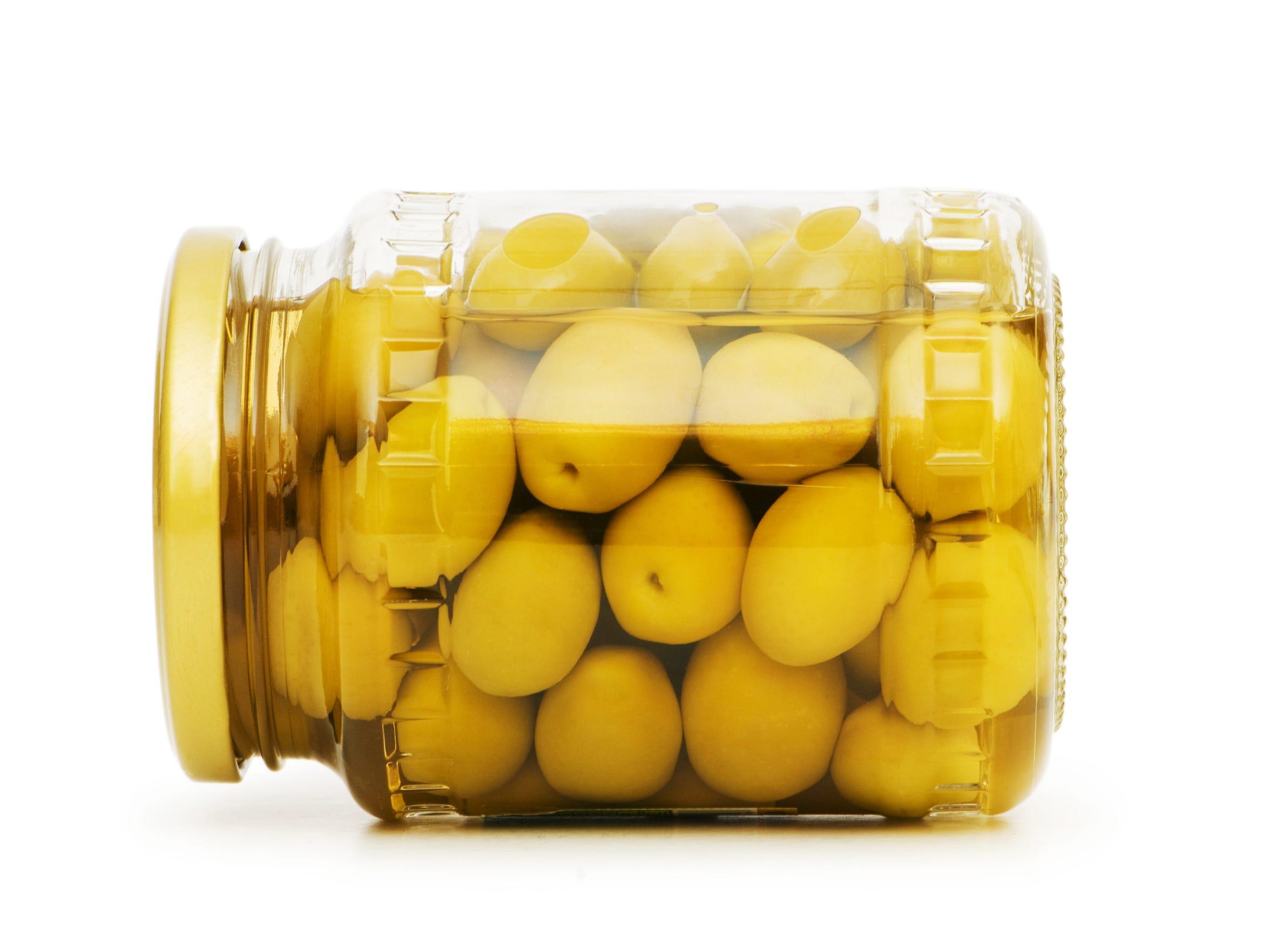 Pickled olives in glass jar.
