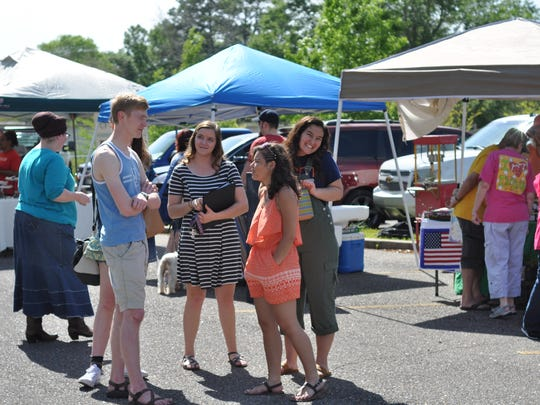 Louisiana College students check out the Pineville Farmers Market, which moved to campus on Thursday.