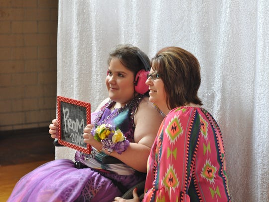 Kaitlin McNeely and paraeducator Shirley Crews, both from Buckeye High School, pose for a photo at the first Rapides Parish high school prom for students with special needs.