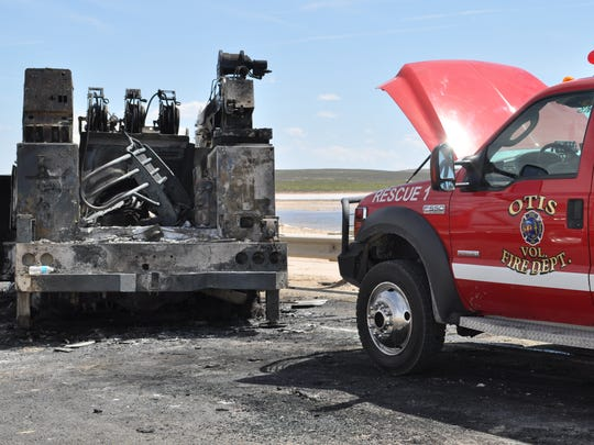 An Eddy County Volunteer Fire Department Vehicle sits near the destroyed truck on State Road 128. At least two people died in the three-vehicle wreck.