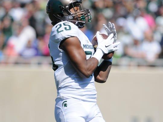 White team wide receiver Darrell Stewart Jr. returns