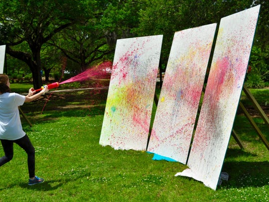 Students flung paint at the canvases with paint guns