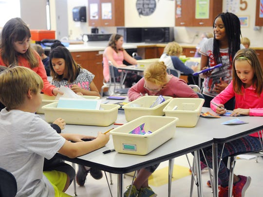 Students work on an assignment during art class in the family and consumer sciences room at Sartell Middle School in fall 2016.
