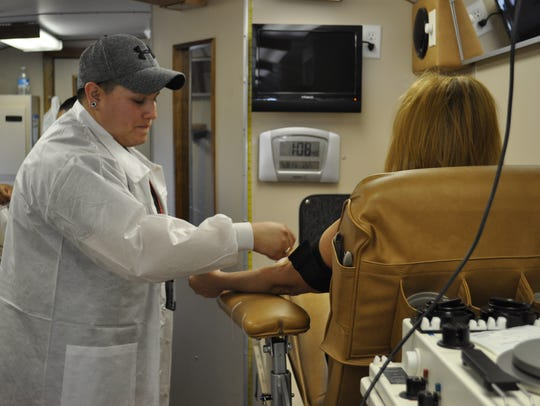 A technician with United Blood Services prepares a