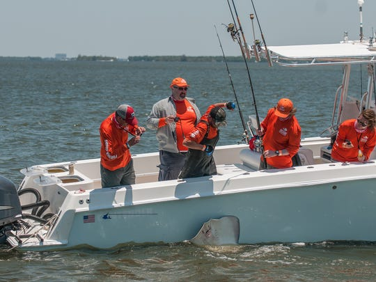 """A member of Fishing 'N Chips reels in a stingray Saturday during the """"Ding"""" Darling and Doc Ford Tarpon Tournament."""