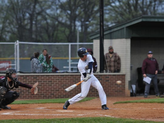 Woodmore's Mason Beachler hits during the Wildcats