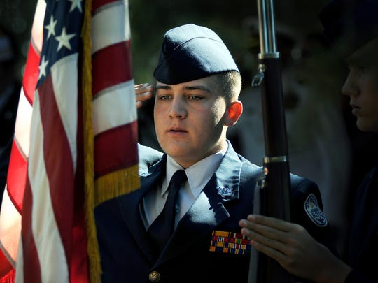 Cadet Glen Gibson, a Mayfield High School U.S. Air Force JROTC color guard member, salutes the American flag during Memorial Day ceremonies in Las Cruces.