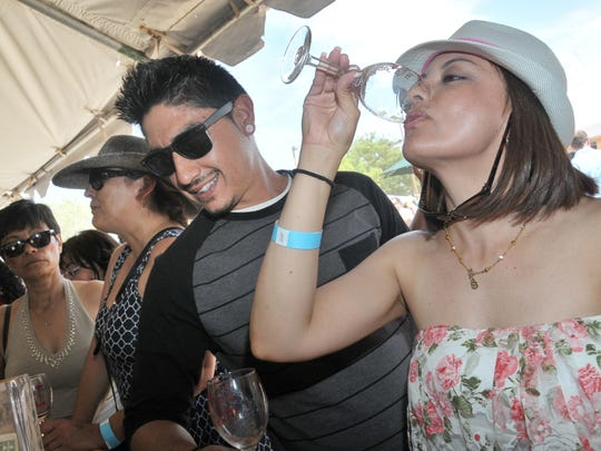 Visitors sample wines at the Southern New Mexico Wine Festival in this file photo. This year a new event join the Memorial Day lineup — Red, White & Brew Wine & Beer Festival at NMSU's Intramural Fields.