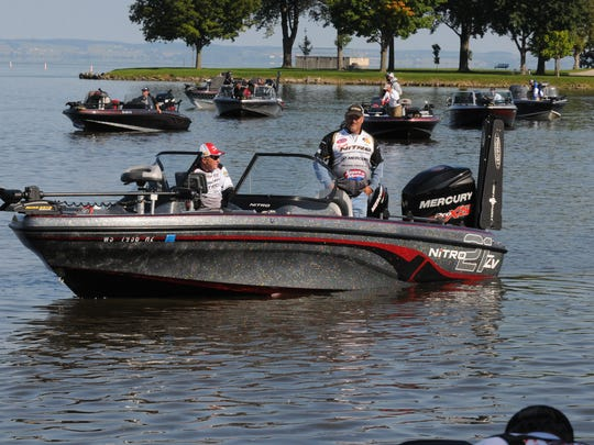 Pro anglers and co-anglers wait for a spot on the docks on the first day of the Cabela's National Walleye Tour Championship held in Oshkosh, in this file photo. This year's event is May 26 and 27.