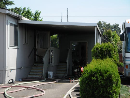 A fire in northeast Salem displaced two people and injured a dog on Wednesday, May 18, 2016.