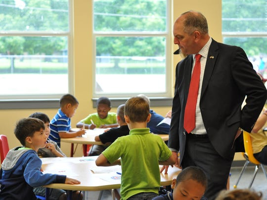 Gov. John Bel Edwards visits with kids at the YWCA on James Street on Tuesday morning.