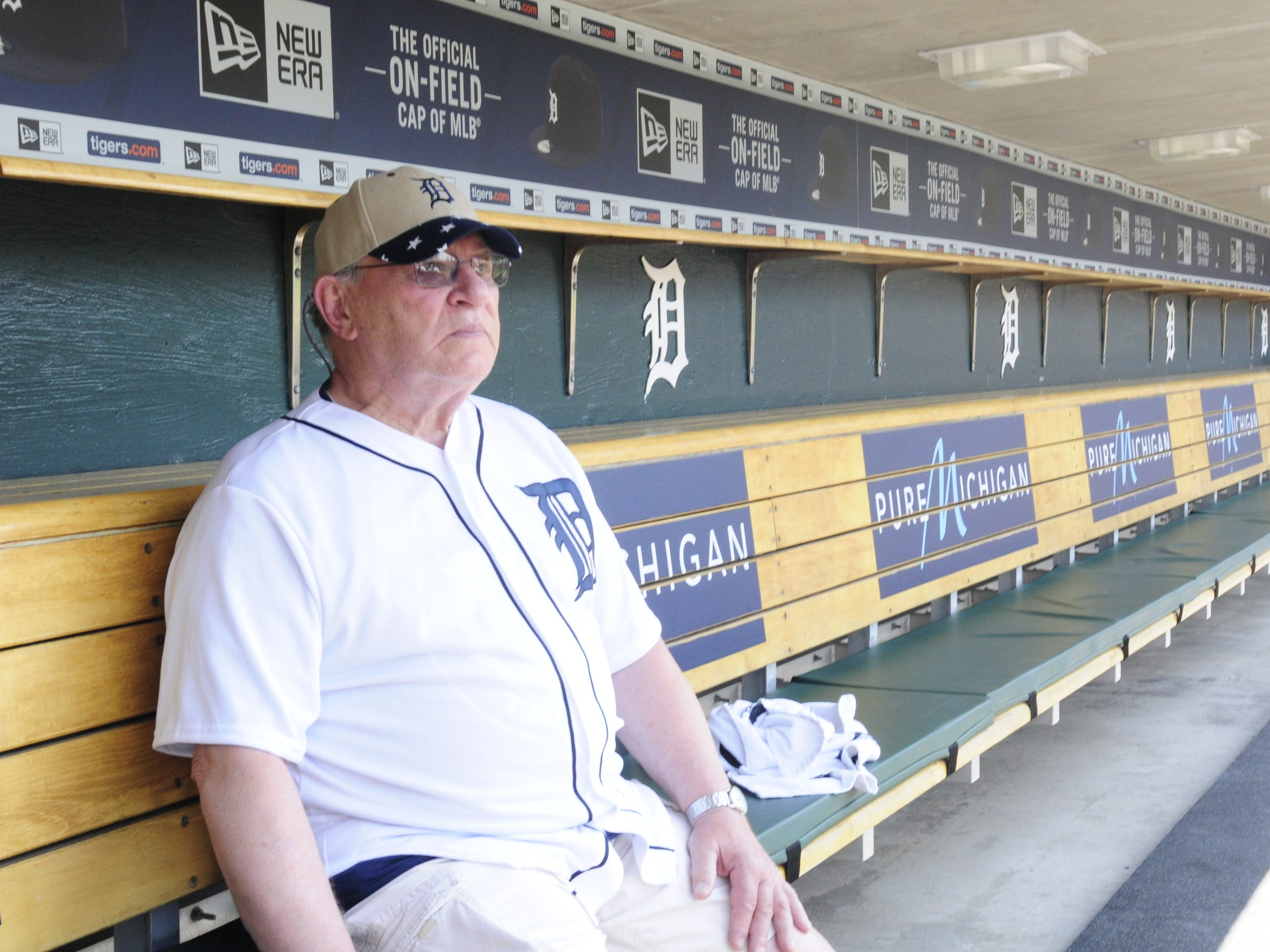 Earl Robinette of Fort Gratiot sits in the home dugout