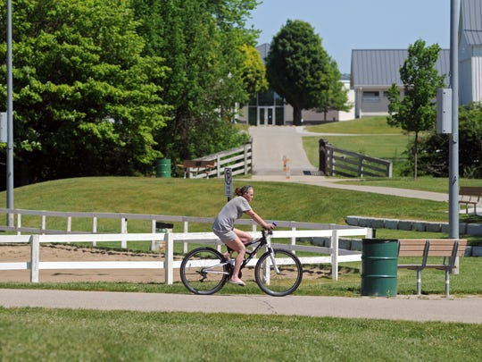 Frances Smith of Avoca bikes around the park Monday, June 6, at Goodells County Park.