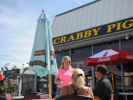Deanna Briddell, Crabby Pig's floor manager, waits