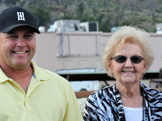Jess Good Candy's triumph is a tribute to the breeding program started by the late Carl Pevehouse and is now carried on by his wife Rozella and their children. Seen here are trainer Clint Crawford and Rozella Pevehouse.