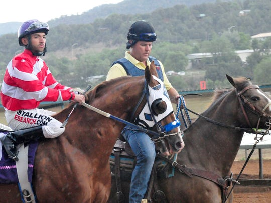 """Jockey Ivan Carnero is seen here with trainer Clint Crawford. Crawford said, """"He's a once in a lifetime horse."""""""