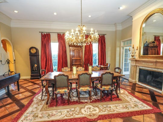 The formal dining room is large and elegant.