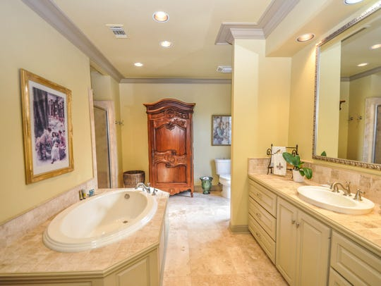 One of two huge master bathrooms.