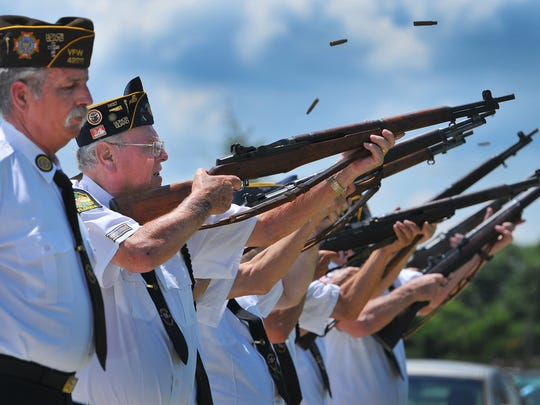 Members of the North Brevard Honor Guard fire a volley