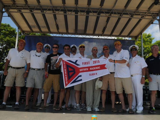 The crew of Shpae is awarded the the 1st place pennant
