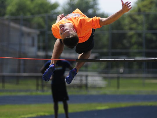 Port Huron Northern senior Colby Nabozny practices his high jump in preparation for the AAU Junior Olympics on July 13, 2016.