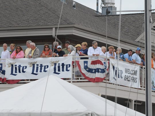 People crowd the balcony of the Port Huron Yacht Club Saturday, July 16, 2016 as sailboat leave the Black River for the start of the Port Huron-to-Mackinac Island Sailboat Race.