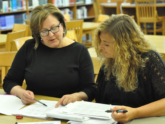 """J.B. Nachman Elementary Principal Becky Warren and fifth-grade ELA teacher Tammy Dean talk after participating in  """"SCALE UP"""" training during the Rapides Parish School District's Summer Institute on July 11-14 at Peabody Magnet High School."""