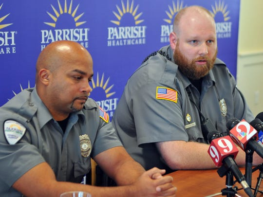 Parrish Medical Center security officers Jason Rowley and Matthew Dolin discuss the shootings at the hospital during a news conference. Their efforts to apprehend the suspect were credited with eliminating the chance of any additional deaths or injuries.