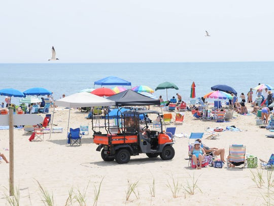 Bethany Beach lifeguards patrol the beach on Friday,