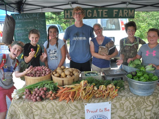 4-H Kids as chefs campers stand with produce they helped pick at Highgate Farm.