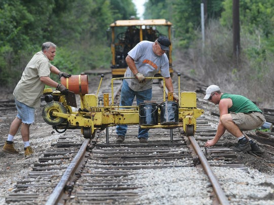 Indiana Transportation Museum volunteers replace rail ties south of 116th Street in Fishers.