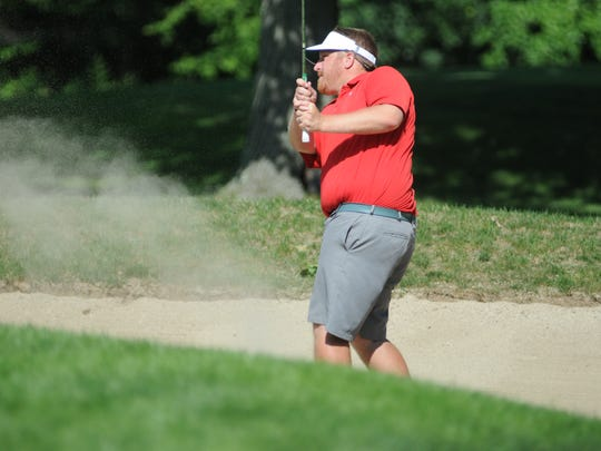 Mike Fisher hits a ball out of the sand in the second round of the Dutchess County Amateur Saturday at McCann Memorial Golf Course.