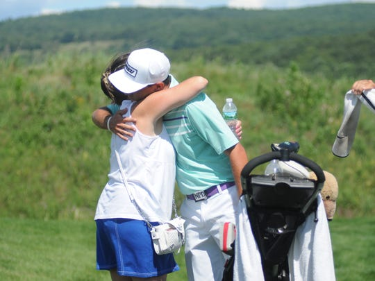 Nick Dilio celebrates his Dutchess County Amateur win with his family on Sunday at The Links at Union Vale.