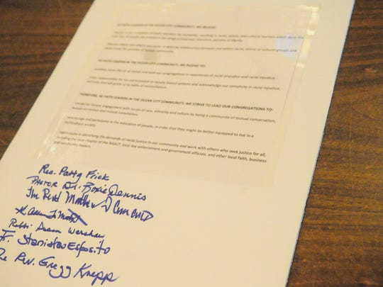 Document signed by church officials to stand and educate against racism
