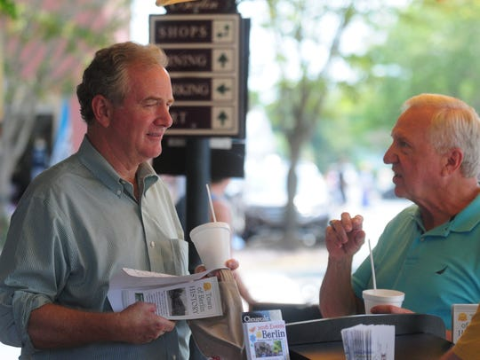Representative Chris Van Hollen (left) eats ice cream