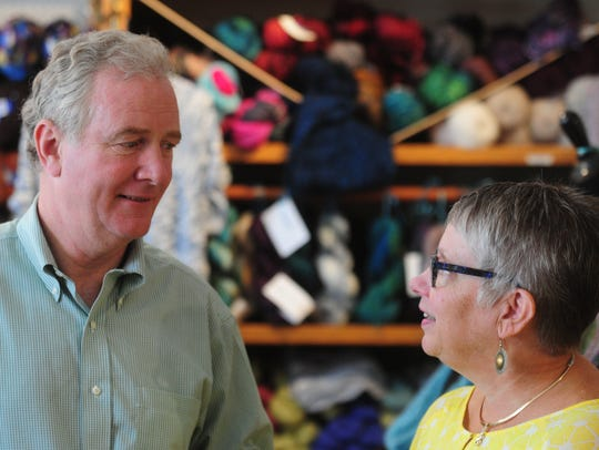 Representative Chris Van Hollen meets with owner of