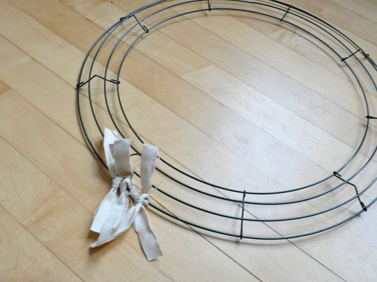 An 18-inch wire wreath frame works well, but smaller frames can be used.