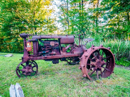 old rusty agriculture farm tractor retired