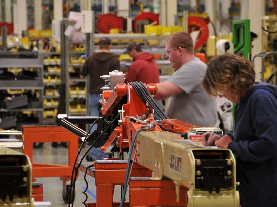 Employees work on the JLG Industries assembly line in Shippensburg on August 30, 2016.