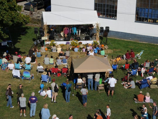 An aerial view of entertainment performances at the Heritage Stage.