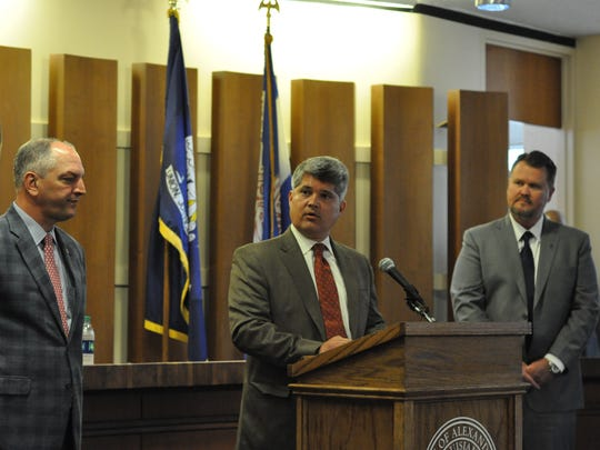 Alexandria Mayor Jacques Roy (center) talks about the project to relocate the Central Louisiana Technical Community College's Alexandria campus to downtown. Listening are Gov. John Bel Edwards (left) and Louisiana Community and Technical College System President Monty Sullivan.